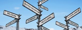 Europe destinations signpost, on blue sky with snow mountain backgrounds